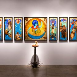 "Exodus Installation: ""Exodus: I see myself in you"" Medium: Gouache, acrylic and gold leaf on wood panel Size with frames: 3.5 feet tall x 10 feet wide Size with sculpture: 6.5 ft x 10 ft 2016"